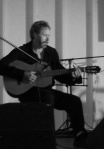 jim_valis_seated_playing_acoustic_guitar