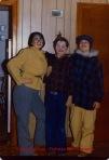 three children mummering in costume