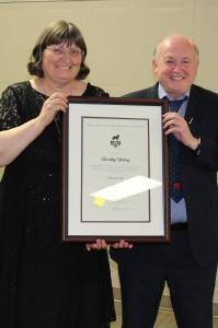 Dorothy Hickey accepting NL Soccer Award of Merin April 2019